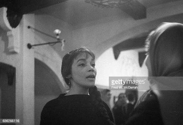 American artist Dody Muller talks with an unidentified woman at the Nonagon Gallery New York New York January 25 1959 They were attending an...