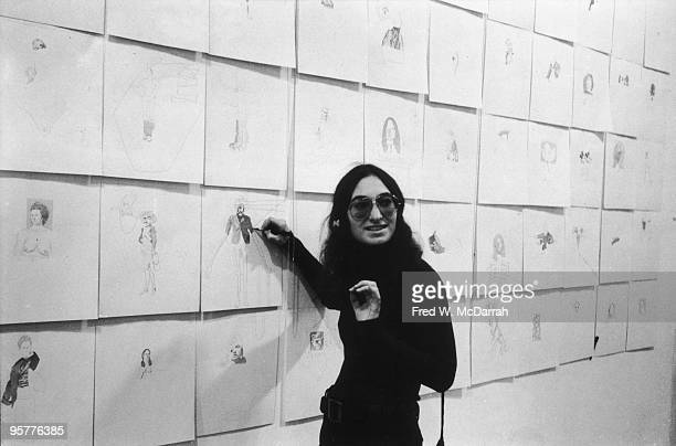 American artist Dotty Attie stands in front of a wall of her drawings on exhibition at the AIR Gallery New York New York December 9 1972 The event...