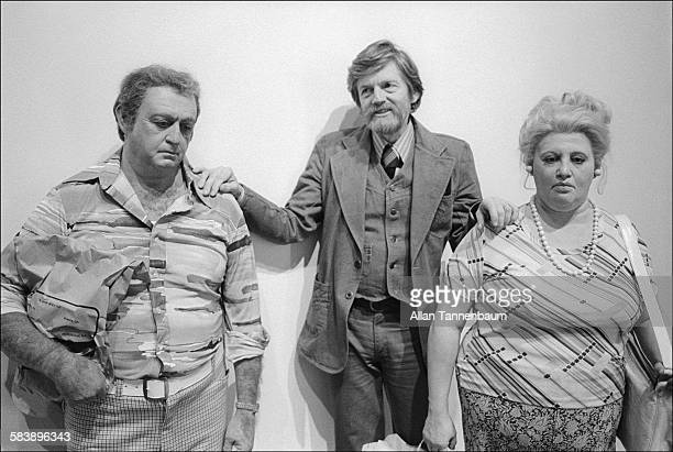 American artist Duane Hansen poses at the Whitney Museum with two of his hyperreal sculptures New York New York February 8 1978