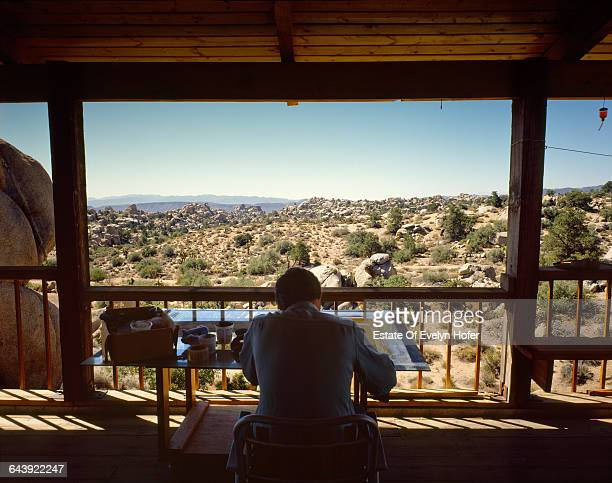 American artist Edward Ruscha painting on the verandah of his house in California, June 1985 .