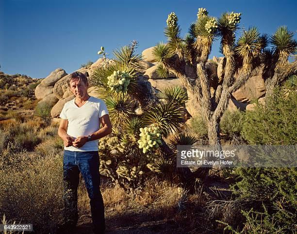 American artist Edward Ruscha with a Joshua tree in the desert, California, June 1985 .