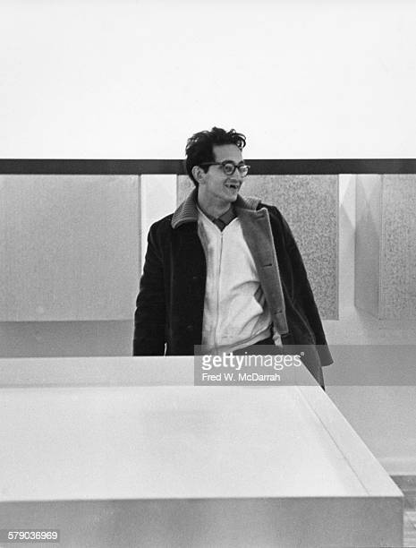 American artist Frank Stella attends an exhibit at the Leo Castelli Gallery New York New York February 6 His smiles show his missing front teeth lost...