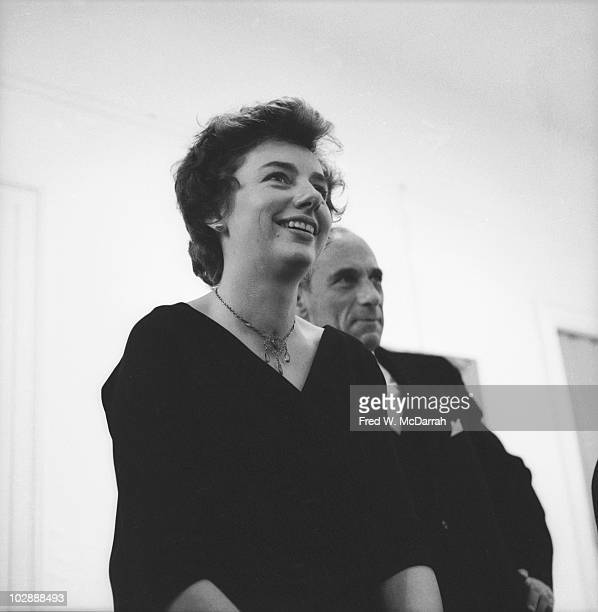 American artist Grace Hartigan smiles as she stands with gallery owner Tibor de Nagy at the opening of a show of her works at the Tibor de Nagy...