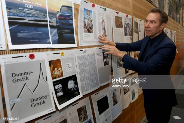 American artist Jeff Koons looks at the mockups of newspaper pages he has guest edited at the offices of Die Welt newspaper at Axel Springer Haus on...