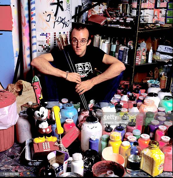 American artist Keith Haring holding outsize paintbrushes in his studio New York City 1985