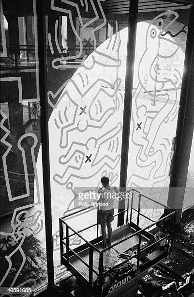American artist Keith Haring working on a mural at the National Gallery of Victoria in Melbourne Australia 1984 Haring's mural temporarily replaces...