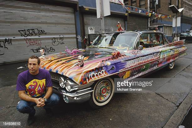 American artist Kenny Scharf with his 'Ultima Suprema Deluxa' a 1961 Cadillac Sedan de Ville with customized paintwork and plastic dinosaurs New York...