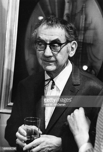 American artist Man Ray holds a glass as he attends a show of his work at the Cordier & Ekstrom Gallery, New York, New York, April 30, 1963.