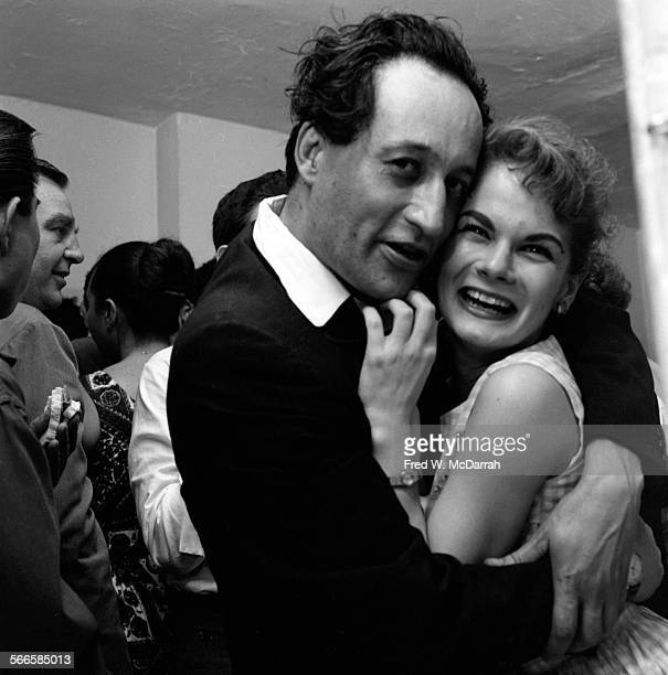 American artist Norman Bluhm embraces an unidentified woman at a Club Jazz party New York New York May 22 1959