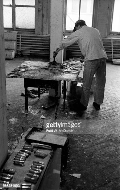 American artist Norman Bluhm works on one of his paintings in his studio New York New York February 22 1961