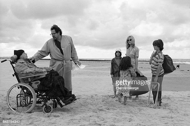 American artist painter and director Julian Schnabel directing French actor Mathieu Amalric and French actress Emmanuelle Seigner on the set of his...