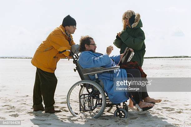 American artist painter and director Julian Schnabel directing French actors Mathieu Amalric and Emmanuelle Seigner on the set of his film Le...