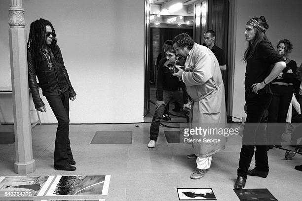 American artist painter and director Julian Schnabel photographs American musician Lenny Kravitz with Michael Wincott on the set of his film 'Le...