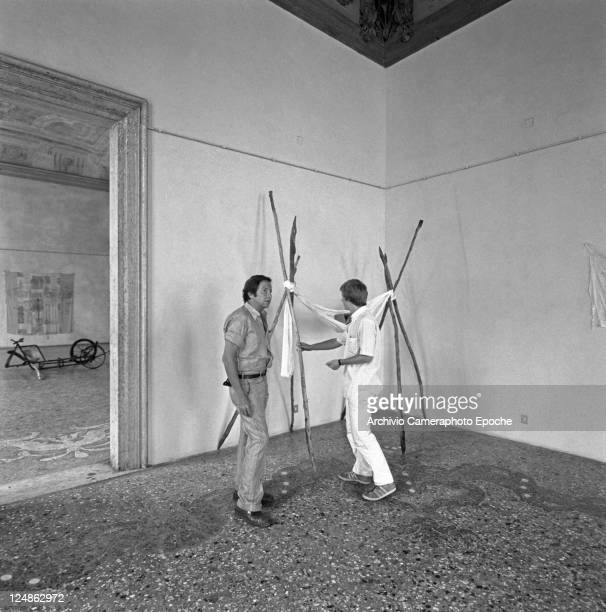 American artist Robert Rauschenberg portrayed inside a venetian palace room while planning the disposition of his works Venice September 4th 1975