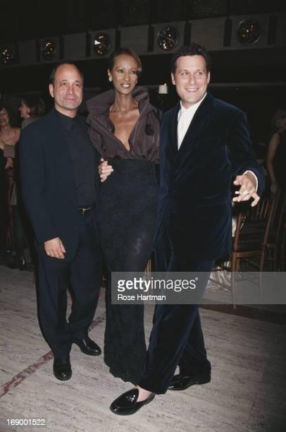 American artist Ross Bleckner, model Iman, and fashion designer Isaac Mizrahi, circa 2000.