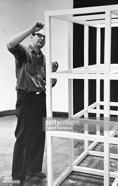 American artist Sol Lewitt paints one of his sculptures as he installs an exhibit at the Jewish Museum, New York, New York, April 26, 1966.
