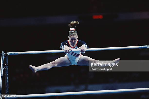 American artistic gymnast Elise Ray pictured in action competing for United States on the uneven bars during competition in the Women's artistic team...