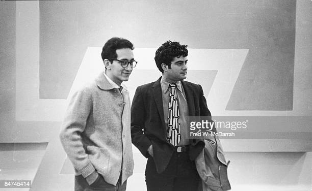 American artists Frank Stella and Larry Poons attend an exhibit of Stella's work at the Castelli Gallery New York New York March 5 1966