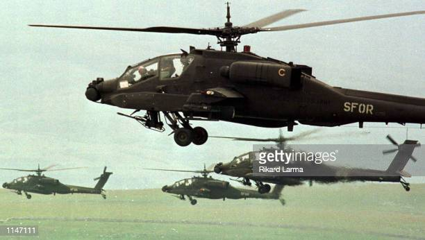 American assault Apache helicopters fly in formation prior to engaging targets during a NATO maneuvers in southern Bosnia on Thursday June 19 1997...