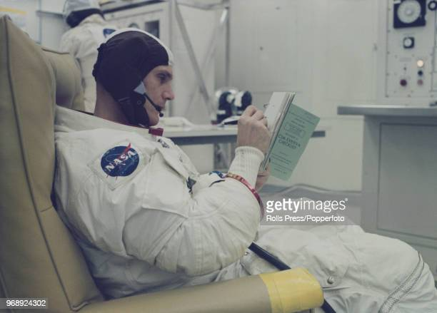 American astronaut and Command Module pilot of the Apollo 16 manned mission to the Moon Ken Mattingly makes final notes in his flight checklist while...