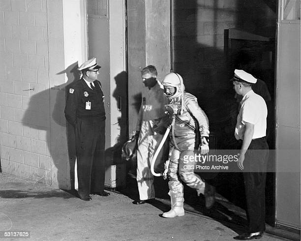 American astronaut and later US senator John Glenn in a spacesuit is escorted to the launch pad in preparation for the America's first manned space...