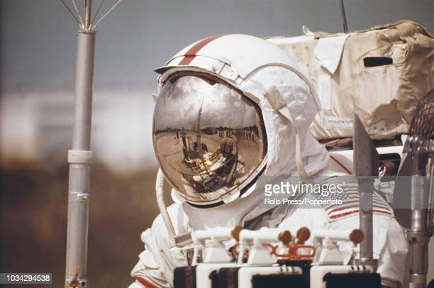 American astronaut and Mission Commander of the Apollo 17 manned mission to the Moon Gene Cernan wearing a full space suit carries out a training...