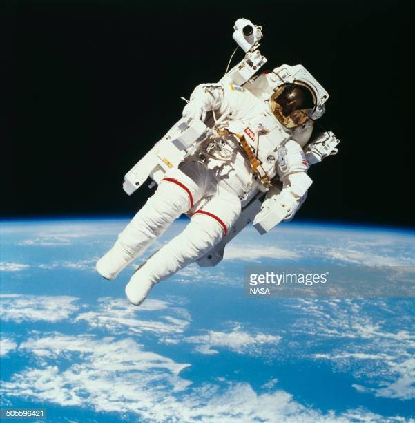 American astronaut Bruce McCandless II photographed from the Space Shuttle Challenger during the first untethered EVA made possible by his nitrogen...