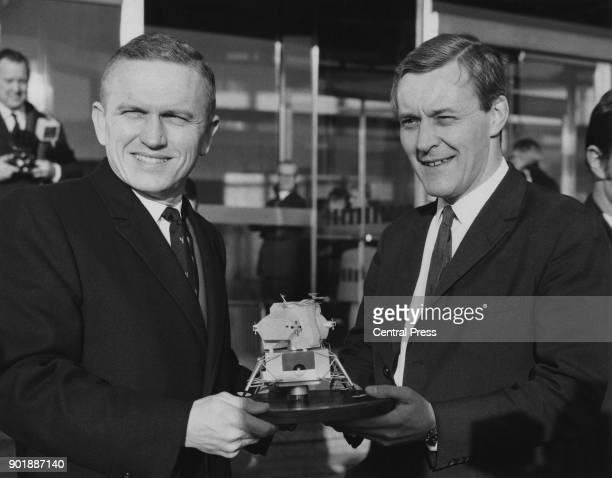 American astronaut Colonel Frank Borman Commander of the Apollo 8 mission receives a model of an Apolllo spacecraft from Tony Benn outside Millbank...