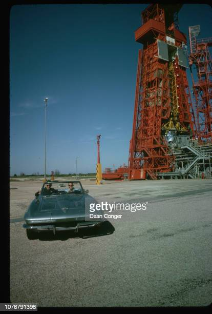 American astronaut Gordon Cooper at the wheel of a 1963 Chevrolet Corvette Sting Ray possibly with his father Leroy Cooper Sr in the passenger seat...