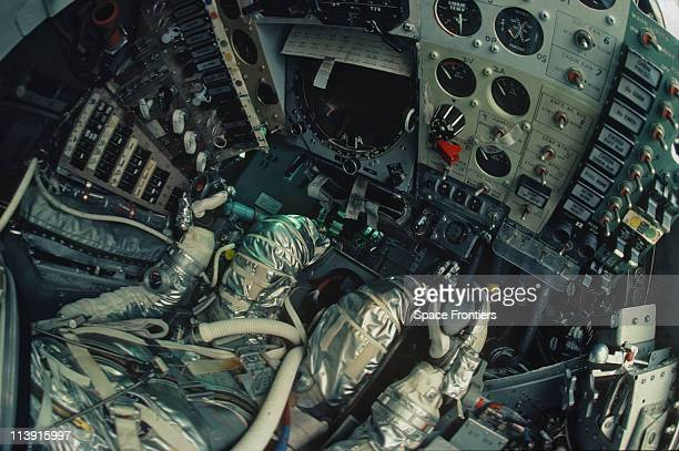 American astronaut John Glenn at the controls of the Friendship 7 capsule in which he orbited the Earth on NASA's MercuryAtlas 6 mission in 1962 The...