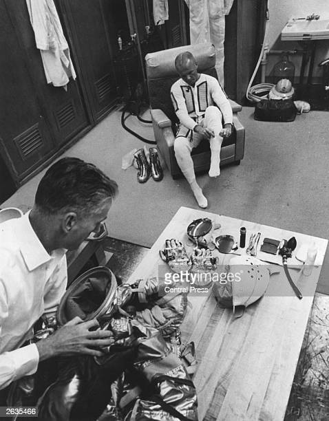 American astronaut John H Glenn and space flight equipment specialist Joe W Schmitt at Cape Canaveral preparing for the MA6 flight