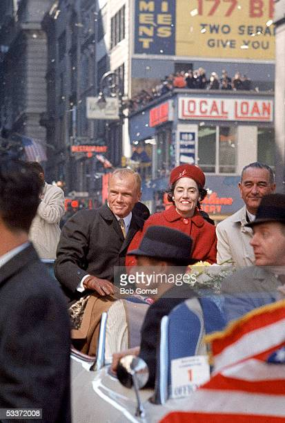 American astronaut John H Glenn Jr and his wife Annie ride with American Vice President Lyndon Baines Johnson during a tickertape parade in Glenn's...