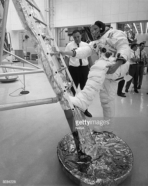 American astronaut Neil A Armstrong descends the ladder of a lunar module training vehicle during practice for an upcoming lunar landing mission...