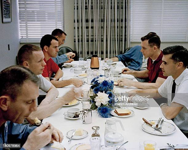 American astronaut Neil Armstrong along with other NASA personnel eats breakfast prior to the liftoff of his Gemini 8 mission Cape Canaveral Florida...