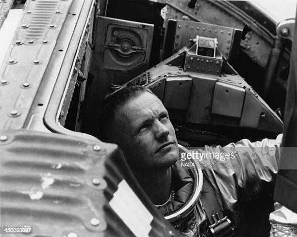 American astronaut Neil Armstrong , command pilot for the Gemini 5 backup crew, prepares to close the hatch on the Gemini Static Article 5...