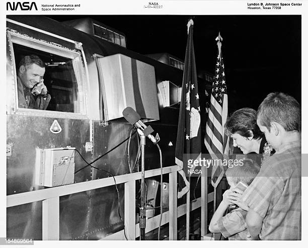 American astronaut Neil Armstrong , commander of the Apollo 11 lunar mission, talks to his wife Jan and sons Mark and Eric from the Mobile Quarantine...