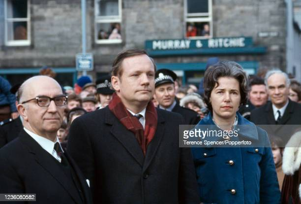 American astronaut Neil Armstrong , his wife Janet and town clerk Eddie Armstrong walking through Langholm, a town in Scotland which was home to...