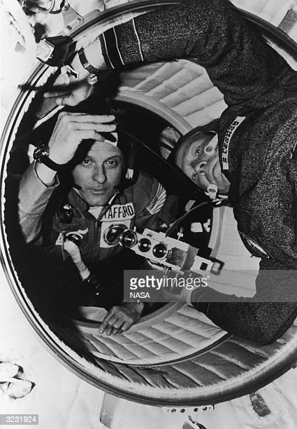 American astronaut Thomas P Stafford and Soviet cosmonaut Aleksey A Leonov move through the hatchway between the Apollo's docking module and the...