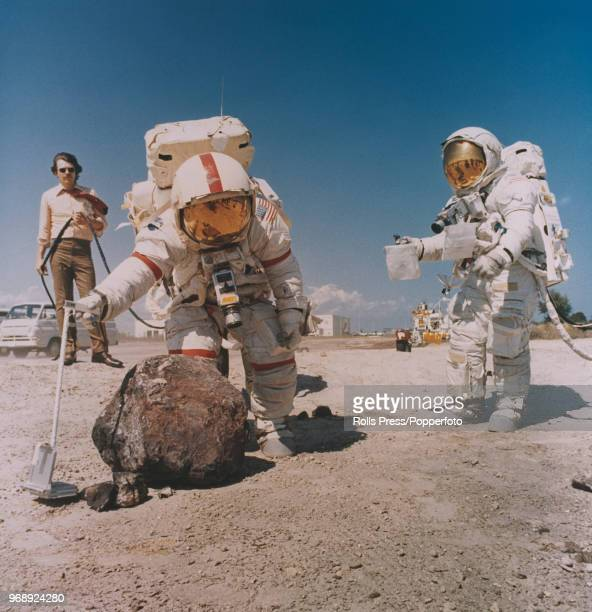 American astronauts and crew of the Apollo 16 manned mission to the Moon Mission Commander John Young and Lunar Module pilot Charles Duke wearing...