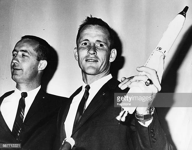 American astronauts James A McDivitt and Edward H White arriving for an after show after returning home safely from their Gemini 4 space flight Paris...
