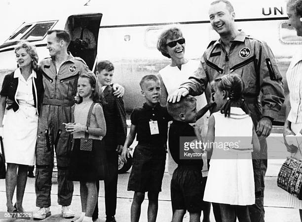 American astronauts James A McDivitt and Edward H White greeting their families after returning home safely from their Gemini 4 space flight USA June...