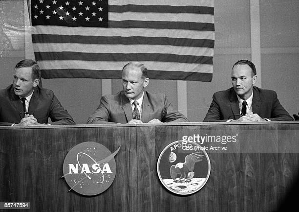 American astronauts Neil A. Armstrong, Edwin E. Aldrin, and Michael Collins take questions during a press conference less than a week before their...