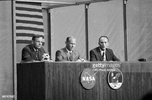 American astronauts Neil A Armstrong Edwin E Aldrin and Michael Collins take questions during a press conference less than a week before their...