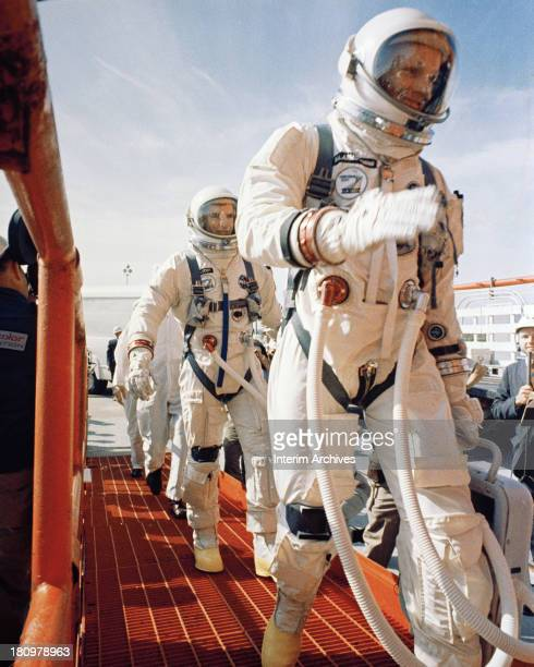 American astronauts Neil Armstrong and David Scott walk to Complex 19, from where their Gemini 8 mission will launch, Cape Canaveral, Florida, March...