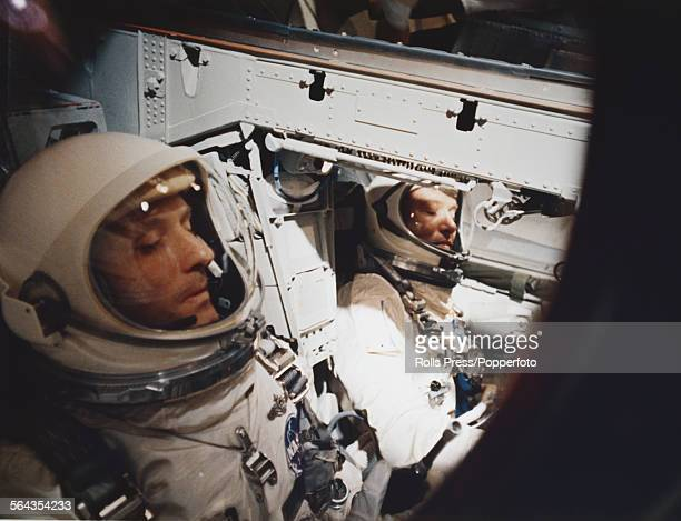 American astronauts Wally Schirra and Tom Stafford pictured together in the capsule of Gemini 6A spacecraft prior to launch at Cape Canaveral in...
