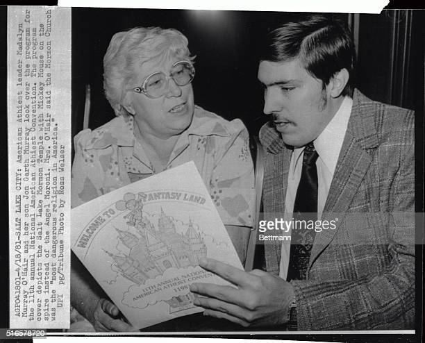 American Atheist leader Madalyn Murray O'Hair and her son Jon Garth Murray look over the program for the Annual National American atheist convention...