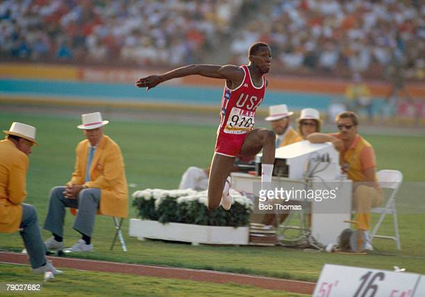American athlete Al Joyner pictured in action during the Men's Triple Jump event in the Memorial Coliseum at the 1984 Summer Olympics in Los Angeles...