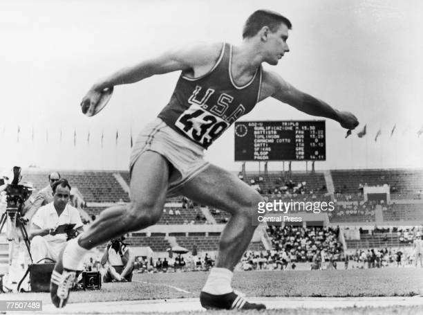 American athlete Alfred Adolf Oerter Jr breaks the Olympic record with a throw of 191 feet 8 1/4 inches in the qualifying round of the discus during...