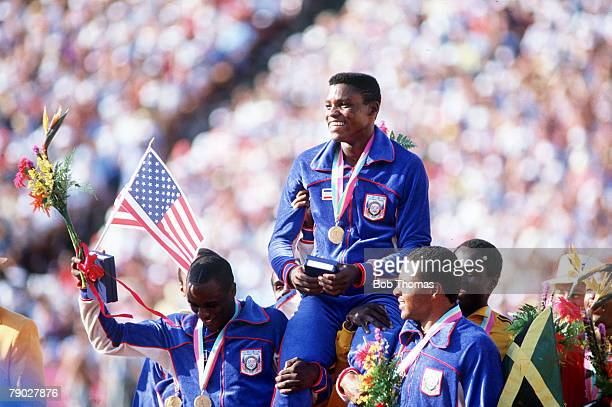 Olympic Games Los Angeles USA Men's 4 x 100 Metres Relay Carl Lewis is carried by his teammates after receiving his fourth gold medal by helping the...