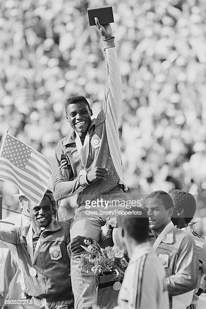 American athlete and sprinter Carl Lewis is carried on the shoulders of his teammates Calvin Smith Ron Brown and Sam Graddy after the United States...